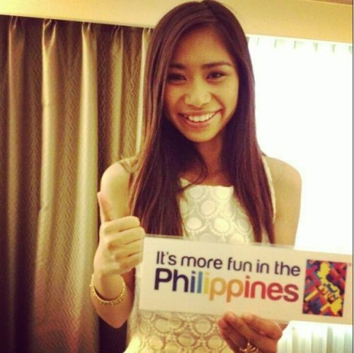 Jessica Sanchez holding a DOT slogan.