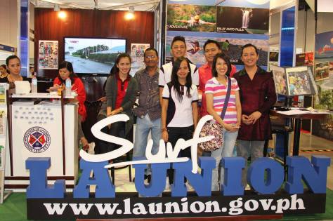 Personnel from the Tourism Operations Unit of the City of San Fernando together with representatives from the City Tourism Council and Provincial Information Office personnel, pose for a souvenir photo at the booth of the Province of La Union on September 7-8, 2013 during the 24th Philippine Travel Mart (PTM) held at the SMX Convention Center, SM Mall of Asia, Pasay City. (Photo by: Alex S. de Guzman-City Media Bureau)